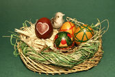 Nest with easter eggs and a bird — Stock Photo
