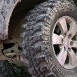Stock Photo: Dirty wheel offroad car