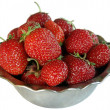 Strawberries in the bowl isolateon white - Stock Photo