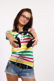 Tonåring anläggning hörlurar — Stockfoto