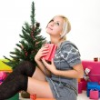 Stock Photo: Young womgives thanks to God at christmastime