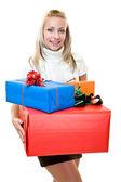 Nice woman giving christmas-box — Stock Photo
