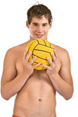 Happy man holding a ball — Stock Photo