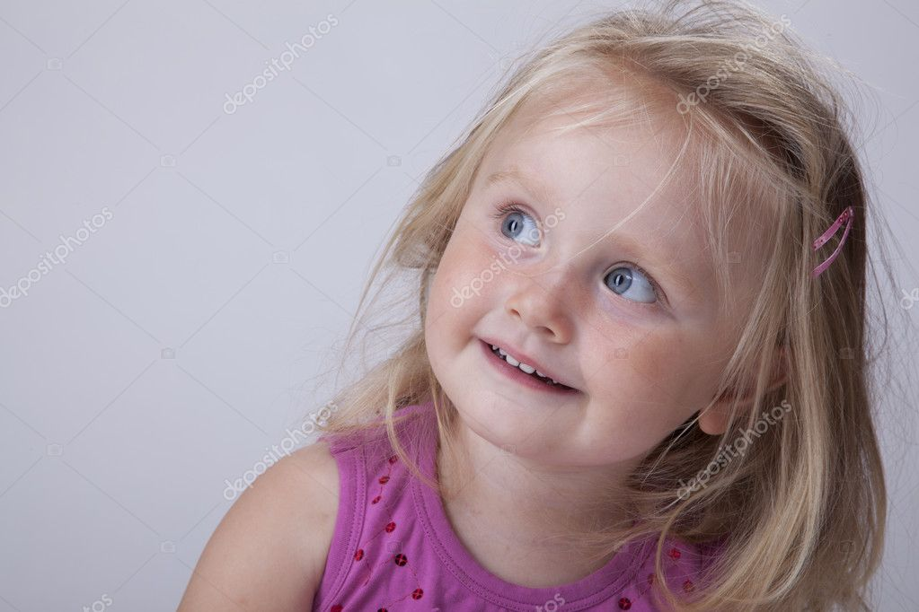 Beautiful little blonde girl in pink blouse — Stock Photo #3537558