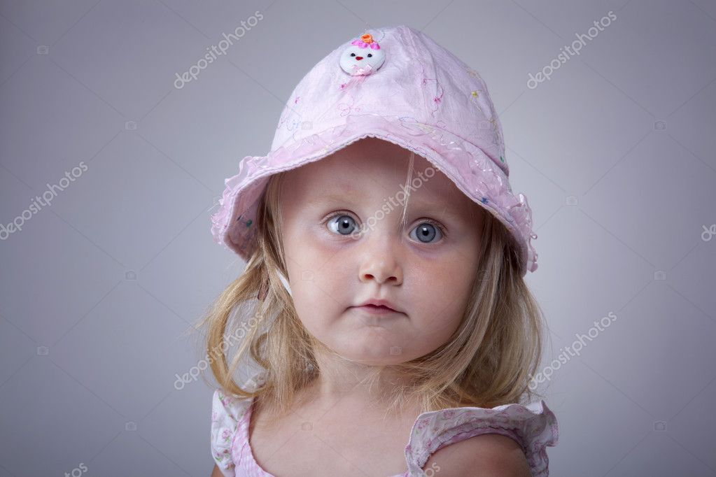 Beautiful small girl with cute hat portrait — Stock Photo #3543876
