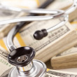 Stethoscope Laying on Stacks of Money — Stock Photo