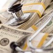 Stethoscope Laying on Stacks of Money - Stockfoto