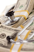 Stethoscope Laying on Stacks of Money — Stockfoto