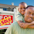 Father and Son and Sold Real Estate Sign — Stock Photo #2790606
