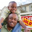 African American Man and Child with Home — Stock Photo