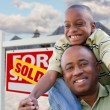 Happy African American Father and Son and Sign — Stock Photo