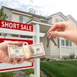 Handing Over Cash For House Keys and Short Sale — Stock Photo
