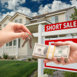 Handing Over Cash For House Keys, Sign - Stock Photo