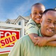 Stock Photo: African American Father, Son Sold Sign
