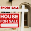 Stock Photo: Red Short Sale Real Estate Sign and Home