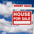 Royalty-Free Stock Photo: Short Sale Real Estate Sign on Clouds