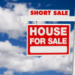 Short Sale Real Estate Sign on Clouds — Stock Photo