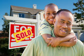 Father and Son and Sold Real Estate Sign — Stock Photo