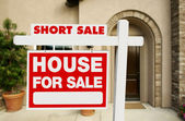 Red Short Sale Real Estate Sign and Home — Stock Photo