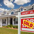 Stock Photo: Sold Short Sale Real Estate Sign, House