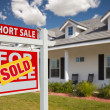 Sold Short Sale Sign and House - Stock Photo