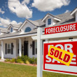 Stock Photo: Sold Foreclosure Home For Sale Real Estate Sign
