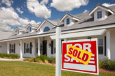 Sold Home For Sale Real Estate Sign and House — Stock Photo
