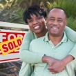 Happy Couple in Front of Sold Sign — Stock Photo