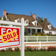 Royalty-Free Stock Photo: Sold Home For Sale Real Estate Sign in Front