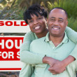 African American Couple Sold Sign - Stock Photo