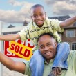 Father and Son in Front of New House — Stock Photo