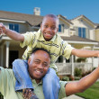 Father and Son in Front of New House - Stock Photo