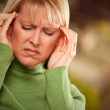 Grimacing Woman Suffering a Headache — Stock Photo