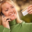 Woman with Credit Card and Phone — Stock Photo