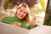 Woman with Credit Card Using Laptop — Stock Photo