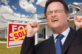 Man in Front of Real Estate and Home — Stock Photo