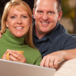 Handsome Happy Couple Using Their Laptop — Stock Photo