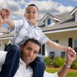 Playful Hispanic Father and Son, House - Stock Photo