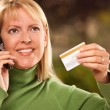 Woman on Phone with Credit Card — Stock Photo