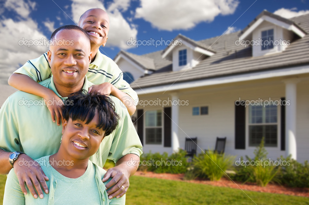 Attractive African American Family in Front of Beautiful House. — Stock Photo #2957340
