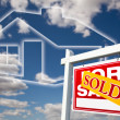 Royalty-Free Stock Photo: Sold Real Estate Sign Over Clouds, House
