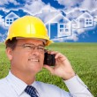 Contractor on Cell Phone Over Houses — Stock Photo