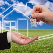 Handing Over Keys on Ghosted Home Icon - Stock Photo