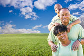Happy African American Family Over Grass — Stock Photo