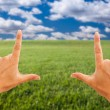 Hands Making a Frame Over Grass Field — Stock Photo