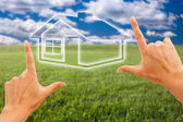 Hands Framing House Over Grass Field — Stock Photo
