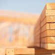 Stack of Building Lumber at Construction Site — Stock Photo #3123113