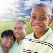 Foto Stock: Handsome African American Boy with Proud Parents