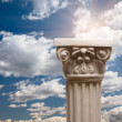 Stock Photo: Column Pillar Over Clouds, Sky and Sun