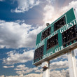 Stock Photo: HIgh School Score Board on Cloudy Sky